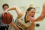 Catamounts guard Sydney Smith (3) gets hit in the face during the women's basketball game between the Cornell Big Red and the Vermont Catamounts at Patrick Gym on Tuesday night December 30, 2014 in Burlington, Vermont. (BRIAN JENKINS, for the Free Press)