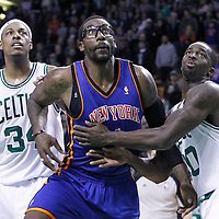 04 March 2012: New York Knicks power forward Amare Stoudemire (1) vies for the rebound with Boston Celtics power forward Brandon Bass (30) during the Boston Celtics 115-111 (OT) victory over the New York Knicks at the TD Garden, Boston, Massachusetts, USA.