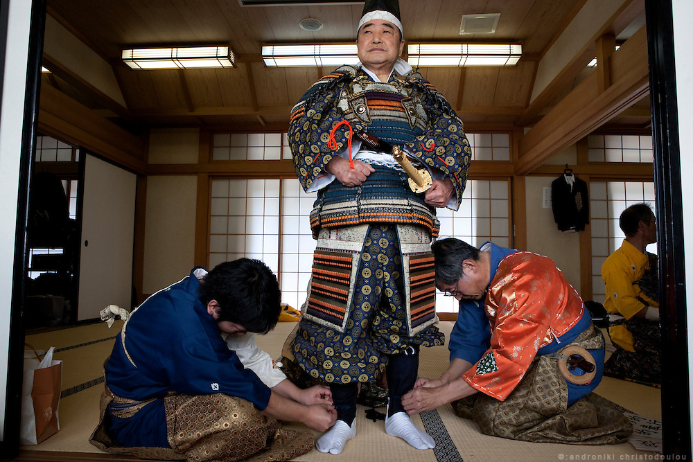 Preparing the traditional costumes and getting dressed for the Yabusame ritual in Tado shrine.
