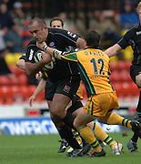 2005/06 Guinness Premiership Rugby, Saracens vs Northampton Saints, Vicarage Road, Watford, ENGLAND: Simon  Raiwalui's break through is challenges by Saints, Rhodri Davies.      05.11.2005   © Peter Spurrier/Intersport Images - email images@intersport-images..