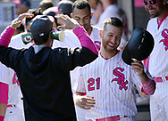 CHICAGO - MAY 14:  Todd Frazier #21 laughs at James Shields #33 of the Chicago White Sox (Shields is wearing Gatorade cups on his ears) while celebrating in the dugout during the game against the San Diego Padres on May 14, 2017 at Guaranteed Rate Field in Chicago, Illinois.  The White Sox defeated the Padres 9-3 .  (Photo by Ron Vesely)  Subject: Todd Frazier; James Shields