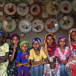 Young girls sit inside a home outside of Al Hudaydah, Yemen. Yemen's women's rights groups agree that child marriage is rampant in every part of Yemeni society.