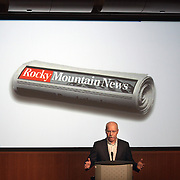 """DENVER - FEBRUARY 26:  E.W. Scripps CEO Rich Boehne speaks to the press at a news conference Thursday about the abrupt closure of The Rocky Mountain News in Denver, Co. Scripps executives  announced to employees Thursday February 26, 2009 that tomorrow's edition of the News would be the final one of the newspaper's almost 150 years of publishing. The newspaper had been put up for sale by its owner, E.W. Scripps, but the search for a buyer proved unsuccessful. """"Denver can't support two newspapers any longer,"""" Scripps CEO Rich Boehne told staffers, some of whom cried at the news. """"It's certainly not good news for you, and it's certainly not good news for Denver."""" The Rocky was founded in 1859 by William Byers, one of the most influential figures in Colorado history. Scripps bought the paper in 1926 and immediately began a newspaper war with The Post. That fight ebbed and flowed over the course of the rest of the 20th century, culminating in penny-a-day subscriptions in the late '90s. The closure will cost 228 newsroom employees their jobs..(Photo by Marc Piscotty/ © 2009)"""