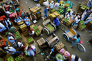 Shoppers flood the open-air market in Oxcutzcab, Yucatan, searching for fresh produce and other goods.