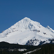 Mount Hood, a 11,239-foot tall mountain in the Cascade Range, stands high above Lolo Pass in northern Oregon.