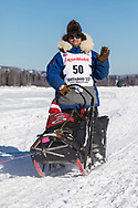 Musher Hugh Neff competing in the 45rd Iditarod Trail Sled Dog Race on the Chena River after leaving the restart in Fairbanks in Interior Alaska.  Afternoon. Winter.
