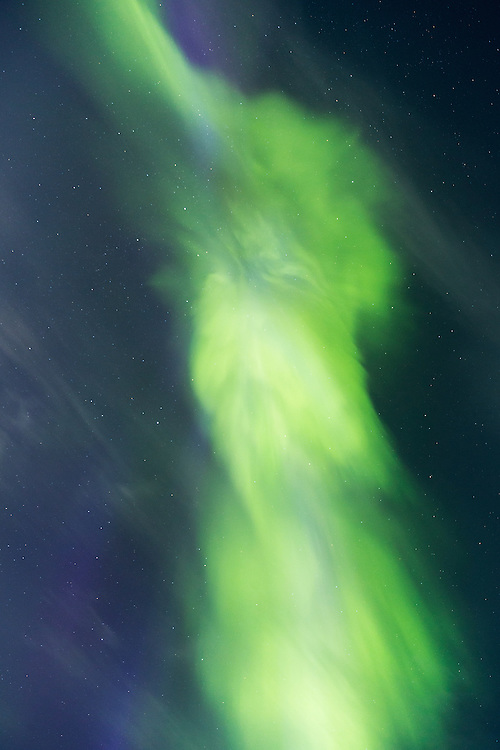 Canada, Nunavut Territory, Arviat, Northern lights known as Aurora Borealis in moonlit night sky above west coast of Hudson Bay at Sentry Island