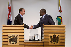 The Prime minister of Zimbabwe (R Dr the Rt Hon Morgan Tavangirai shakes hands with the Prime Minister of New Zealand John Key during a joint press conference at the Beehive, Wellington, New Zealand, Wednesday, July 25, 2012. Credit:SNPA / Marty Melville