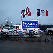 Store carts are used as vehicle barriers as Former Gov. Mitt Romney (R-MA), wife Ann, and New Jersey Gov. Chris Christie attend a rally Friday, December 30, 2011, in West Des Moines, IA...Photo by Khue Bui
