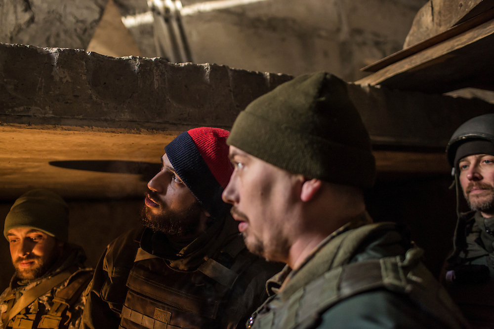 DEBALTSEVE, UKRAINE - FEBRUARY 8, 2015: Ukrainian soldiers gather in an underground bomb shelter behind a medical treatment point for Ukrainian fighters in Debaltseve, Ukraine. Fighting between pro-Russia rebels and Ukrainian forces there over the past two weeks has dealt steady casualties to Ukrainian fighters and civilians. CREDIT: Brendan Hoffman for The New York Times
