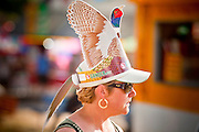 "01 SEPTEMBER 2011 - ST. PAUL, MN:  A woman wears a cut out pheasant hat from Gander Mountain, a Minnesota based sporting and outdoors retailer, at the Minnesota State Fair. The Minnesota State Fair is one of the largest state fairs in the United States. It's called ""the Great Minnesota Get Together"" and includes numerous agricultural exhibits, a vast midway with rides and games, horse shows and rodeos. Nearly two million people a year visit the fair, which is located in St. Paul.   PHOTO BY JACK KURTZ"