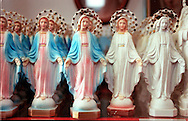 MEDJUGORJE, BOSNIA-HERCEGOVINA: Small statues of the Virgin Mary for sale in a gift shop in the village of Medjugorje, Bosnia-Hercegovina. Since 1981, millions of pilgrims and tourists have visited the remote site and the tourism trade has exploded. Now pilgrims can buy everything from western style pizza and hamburgers to Virgin Mary bottle openers.   (Photo by Robert Falcetti). .