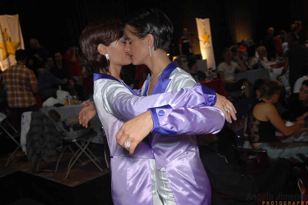 """Claudia Reger, right, and Nadine Dlouhy, the """"Swinging Sisters"""" of Cologne, Germany, prepare to compete in the women's standard A division of the same-sex ballroom dancing competition during the 2007 Eurogames at the Waagnatie hangar in Antwerp, Belgium on July 13, 2007. ..Over 3,000 LGBT athletes competed in 11 sports, including same-sex dance, during the 11th annual European gay sporting event. Same-sex ballroom is a growing sports that has been happening in Europe for over two decades."""