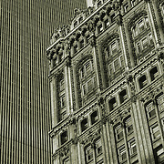 New York City contrasting architecture styles, World Trade Center South Tower  layered behind 90 West Street Building (formerly Coal & Iron or Railroad & Iron Bldg), Cass Gilbert architect, shot from Hudson River side, 1981. Heavily damaged on 9/11 attacks.