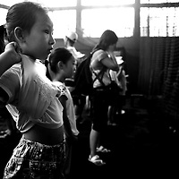 BEIJING, JULY -18: a school class watches the Beijing Tiger  players warm-up indoors , Beijing, July 18, 2007.