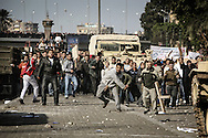 Supporters of Egyptian president Mubarak seen as they clash against protesters occupying Tahrir Square after they failed to force out the peaceful demonstrators from the square. The protesters then repelled Mubarak's supporters, both groups hurling stones at each others. 02 February 2011.