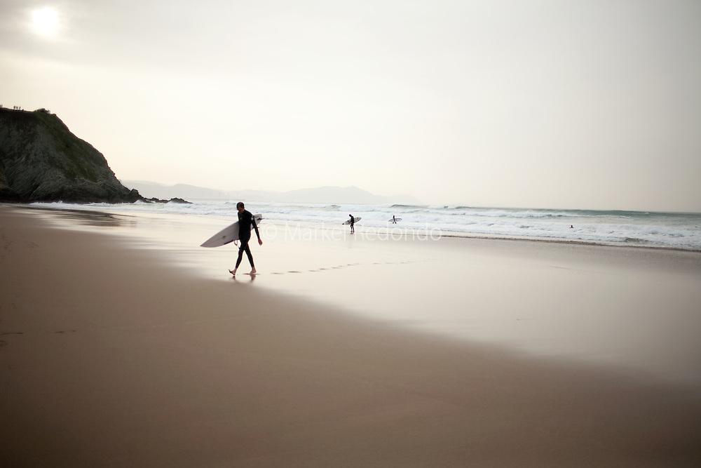 Surfers at Sopelana beach.