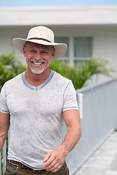 middle aged man enjoying a walk by a motel in Florida