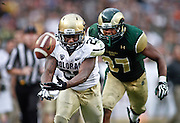 SHOT 9/1/13 6:39:53 PM - Colorado's Tony Jones #26 tries unsuccessfully to haul in a pass in front of Colorado State's Aaron Davis #37 during the 2013 Rocky Mountain Showdown at Sports Authority Field at MiIe HIgh Stadium in Denver, Co. Colorado won the annual in-state rivalry 41-27. (Photo by Marc Piscotty / © 2013)