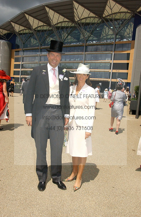 The HON.HARRY &amp; MRS HERBERT at the first day of the Royal Ascot racing festival 2006 at Ascot Racecourse, Berkshire on 20th June 2006.<br /><br />NON EXCLUSIVE - WORLD RIGHTS