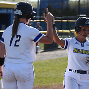 Delaware Outfielder Gabby Klecko (73) and Delaware utility player Anna Steinmetz (12) celebrate at home plate during a Colonial Athletic Association regular season softball game between Delaware and Hofstra Saturday, April 16, 2016, at Delaware softball stadium in Newark, Delaware.