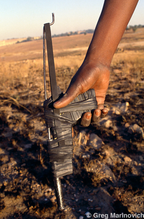 ANC supporter with a Kwash or homemade gun in clashes with Inkatha Freedom Party members Kwamashu, KwaZulu Natal, South Africa. 1994