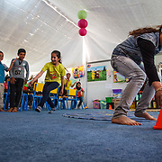 """Playing games in the Mercy Corps child friendly space """"Tom and Jerry"""" helps the children acclimate to their new environment and heal from trauma. Azraq camp for Syrian refugees, Jordan, May 2015."""