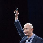 June 18, 2014 - Seattle, Washington, United States: Amazon.com Founder and CEO Jeff Bezos presents the Amazon Fire Phone during a product launch event at Fremont Studios. Bezos is also the owner of The Washington Post and founder of Blue Origin.