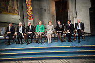 From left, Nobel Peace prize winners Jose Manuel Barroso,  Herman Van Rompuy and Martin Schulz along with members of the Norwegian Nobel Committee Kaci Kullmann Five, Inger Marie Ytterhorn, Berit Reiss Andersen, Gunnar Staalsett and Geir Lundestad during the Nobel Peace Prize ceremony.