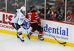Nov 5, 2008; Newark, NJ, USA; New Jersey Devils left wing Zach Parise (9) gets hit by Tampa Bay Lightning right wing Adam Hall (18)during the second period at the Prudential Center.