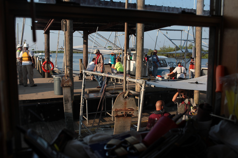 On the anniversary of Hurricane Katrina, fishermen have their boats loaded with boom to take out to help in the effort to clean up the BP oil spill on Delacroix Island, LA August 25th, 2010.