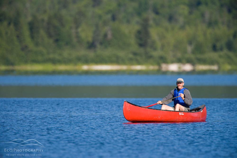 Canoeing on Maine's Katahdin Lake.  Near Baxter State Park.