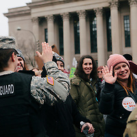 Protestors high five women National Guard members while marching in the Women's March on Washington D.C., January 21, 2017