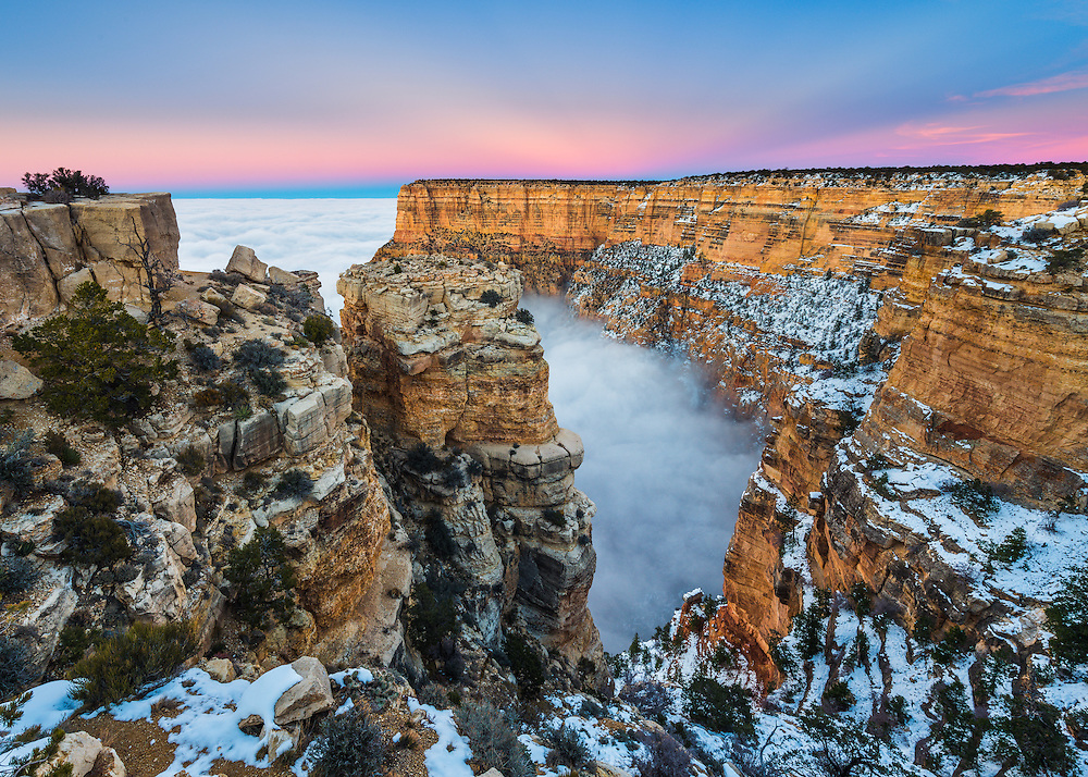 A rare weather phenomenon called a temperature inversion fills the Grand Canyon with clouds. This happens when cold air is trapped below the rim by hot air above. This particular event is very rare in that the entire canyon has been filled with fog, something which only happens once every 10 years.