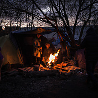 Migrant are seen warming at a wood fire in the Dunkerque camp, France. FEDERICO SCOPPA/CAPTA