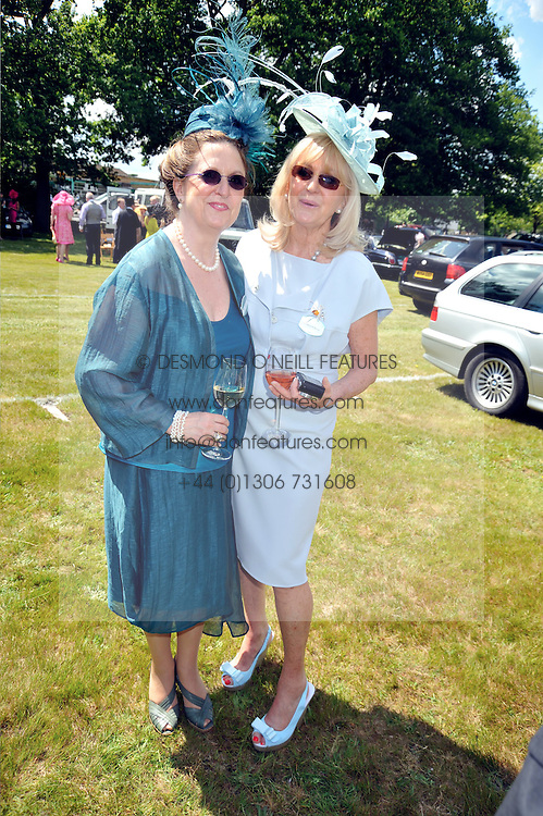 Left to right, sisters VICTORIA WATSON and LIZ BREWER at at the first day of the 2009 Royal Ascot racing festival on 16th June 2009.