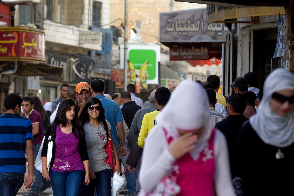 Secular students girls walk on the Al MAnara Square in Ramallah...Photo by Olivier Fitoussi.
