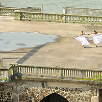 MR. Model relased photo. Two ballerinas dance in the old ruins of Panama next to the Pacific Ocean.