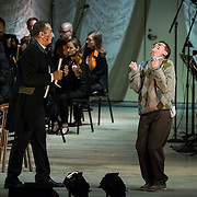 """Ashraf Sewailam (bass-baritone) as """"Commendatore"""" and Keith Jameson (tenor) as """"Snibblesworth"""" in the world premiere of Steven Stucky and Jeremy Denk's The Classical Style: An Opera (of Sorts) at the 68th Ojai Music Festival at Libbey Bowl on June 13, 2014 in Ojai, California."""