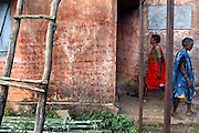 In the village of Nendra some seven kilometres away from the Salwa judam camp of Errabore lies a small building covered with naxalite graffiti. The words explain why villagers must not vote in the elections and not support the state as well as general Maoist propaganda.