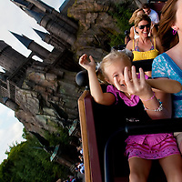 ORLANDO, FL -- May 29, 2010 -- Sarah Karp, 13, right, and her sister, Claire Karp-Hauser, both of Sarasota, Fla., ride the Flight of the Hippogriff at The Wizarding World of Harry Potter at Universal Orlando in Orlando, Fla., on Saturday, May 29, 2010.  The 20-acre park features a new ride inside the Hogwarts Castle, shops along the village of Hogsmeade, and is scheduled to officially open on June 18.