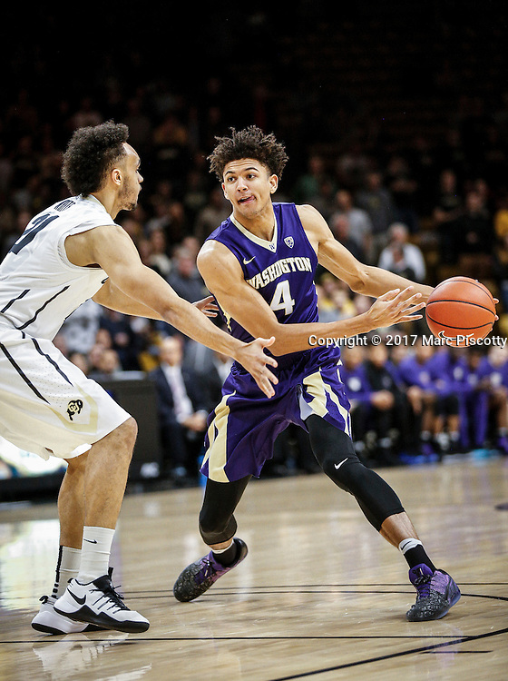 SHOT 2/9/17 9:00:02 PM - Colorado's Derrick White #21 defends the lane against Washington's Matisse Thybulle #4 during their regular season Pac-12 college basketball game at the Coors Events Center in Boulder, Co. Colorado won the game 81-66. (Photo by Marc Piscotty / © 2017)