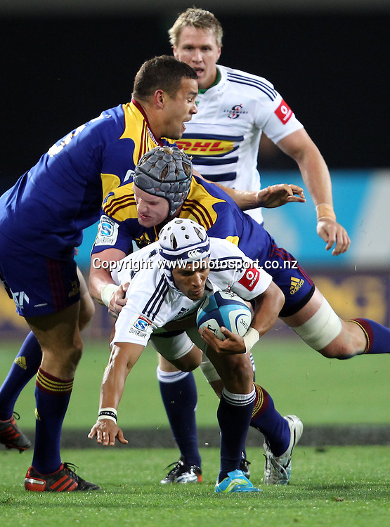 Gio Aplon looks to bust the Highlanders defence.<br /> Investec Super Rugby - Highlanders v Stormers, 7 April 2012, Forsyth Barr Stadium, Dunedin, New Zealand.<br /> Photo: Rob Jefferies / photosport.co.nz