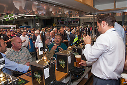 Olympia, London, August 12th 2014. Brisk business is done at the pumps as hundreds of people sample 900 different real ales, international beers, ciders and perries at the CAMRA Great British Beer Festival.
