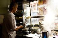 the proprietor of a Kuching kopi tiam (coffee shop) making noodles