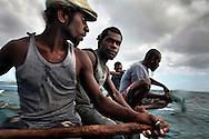 Ni Vanuatu fishermen rowing a canoe. Uleveo, Maskelyne Island, Malampa Province, Malekula, Vanuatu