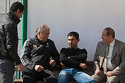 Manuel Jose, (l, seated) the Portuguese Coach of the Egyptian football team Al-Ahly speaks with player Mohamed Barakat (c) during a Feb 20, 2012 practice at the Ahly club stadium in Cairo, Egypt. Barakat says he has retired from professional football in the wake of post-football match violence February 2nd, 2012 that killed 74 and injured hundreds more in the Port Said, Egypt stadium.  (Photo by Scott Nelson)