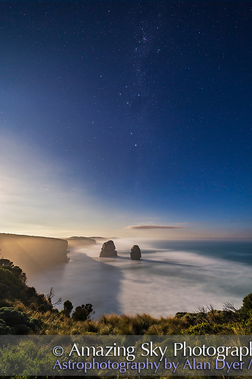 The Southern Cross (Crux), the Pointer Stars (Alpha and Beta Centauri) and the stars of Carina (at top) rising in the moonlit sky over the sea stacks at the eastern end of the Twelve Apostle sea stack formation, on the Great Ocean Road, Victoria, Australia.<br /> <br /> This was April 12, 2017 on a very clear night. The Moon, a day past full, is rising off frame at left, brightening the sky and lighting the landscape and seascape. <br /> <br /> This is a stack of 8 x 13-second exposures for the ground and sea, mean combined, to smooth noise and further blur the waves, plus one 13-second exposure for the sky. All at f/2.5 with the 14mm Rokinon lens and Canon 6D at ISO 800.