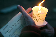 A candle burns during a prayer service in Milwaukee. (Sam Lucero photo)
