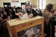 Woman cast her vote inside a polling station in Garden City district on November 28, 2011 in Cairo, Egypt.